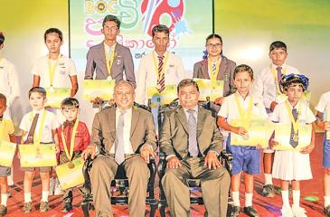 The Bank's Chairman,  Ronald C. Perera and the General Manager D.M. Gunasekara (centre) with national winners of the art competition.