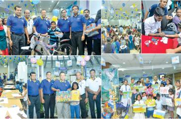 Jonathan Alles MD/CEO of HNB and Senior officials of HNB at the Singithi Savings Day celebrations.