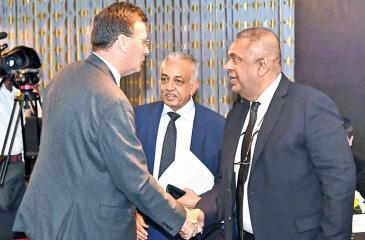 Minister of Finance and Mass Media, Mangala Samaraweera with Australian High Commissioner Bryce Hutchesson