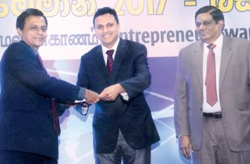Samansiri Senamanthila of Panadura receives the award for the best entrepreneur in the agriculture sector - micro category.