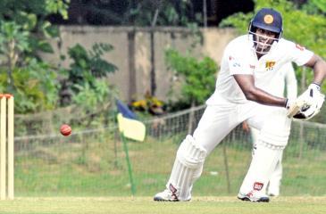 Sri Lanka's Angelo Mathews plays a shot during the Sri Lanka vs India's Board President XI cricket match in Kolkata on November 11, 2017.  / AFP