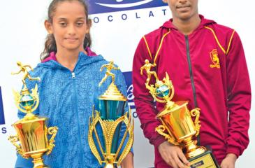 The Best Athletes of the John Tarbet Junior Championship Sadini Kaveesha of Vijitha Central College, Dickwella (on left) and W.H.H.M. Abeysekara of Siddhartha MMV, (on right) Balapitiya with their trophies. Picture by Ranjith Asanka