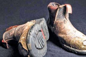More than 2000 pairs of work boots were found in the man's home.
