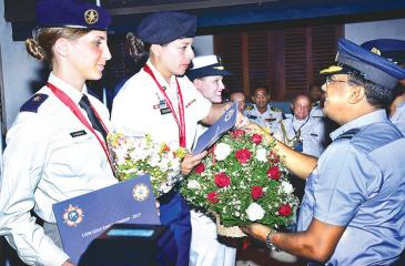 USA women Services team receives their Championship Award from Commander of Sri Lanka Air Force, Air Marshal Kapila Jayampathy