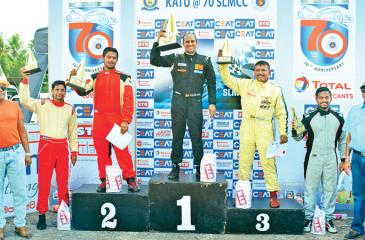 Best Driver at the SLMCC's Anniversary celebration Meet held at the Katukurunda circuit meet Ashan Silva on the podium after receiving the award from Air Force Commander Air Marshal Kapila Jayampathy with runners up Kushan Peiris, Missaka Naveen, Manisha Gunetilleke, Irfan Fuard and President of SLMCC Ananda Jayasekera.