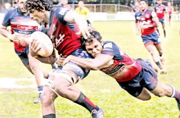 Kandy SC's  Fazil Marija tackling a CR&FC player during  their  Dialog A division   rugby match at Longden  Place  yesterday.     Pic. Chinthaka Kumarasinghe