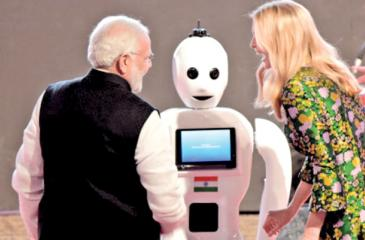 Indian Prime Minister Narendra Modi and Ivanka Trump greet Mitra, the made in India robot.