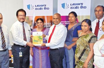 Asanga Ranasinghe - LAUGFS Holdings Sector Managing Director, Thilak De Silva – LAUGFS Group Managing Director, Ms. Priyatha Nanayakkara - Director of Education (Mathematics Division) and Sunil Hettiarachchi, Secretary to the Ministry of Education together with other senior Ministry representatives at the official handing over of the Nana Maga text books to the Ministry of Education.