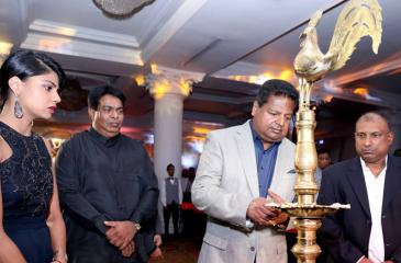 Nalin Welgama – Chairman Ideal Group lighting the oil lamp to inaugurate Club Mahindra in Sri Lanka. From left Ms Nimisha Welgama – Advisor Corporate Strategy and New Business Development, Ideal Group, Richard de Zoysa - MD Ideal Retreats (Pvt) Ltd and Aravinda de Silva - Deputy Chairman Ideal Group