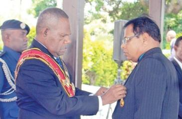 P.M.N. Bandara (on right) receiving the honours from the Governor General of Papua New Guinea Grand Chief Sir Bob Dadaeat