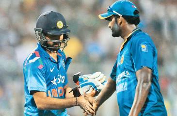 Rival skippers Rohit Sharma and Thisara Perera.