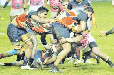 A tussle for the ball in the Dialog 'A' division rugby match between defending champs Kandy SC and Havelocks SC at Havelock Park under lights yesterday. (Pic by Sudam Gunasinghe)