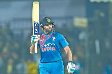 Indian captain Rohit Sharma raises his bat after scoring his century during the second T20 international cricket match between India and Sri Lanka at the Holkar Stadium in Indore on December 22.  AFP