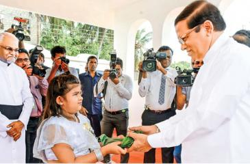 President Maithripala Sirisena being welcomed by a child at the State Christmas Festival held at the Hindu Cultural Centre, Trincomalee.