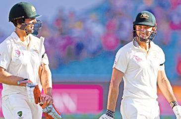 The Marsh brothers Mitchell and Shaun who were involved in an unfinished century partnership walk off the field at the end of the third day of the fifth and final Ashes Test against England at the Sydney Cricket Ground on Saturday. - AFP