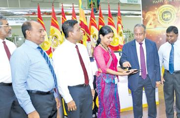 Bank Chairman Ronald C. Perera and General Manager D.M. Gunasekara launch 'B-app'