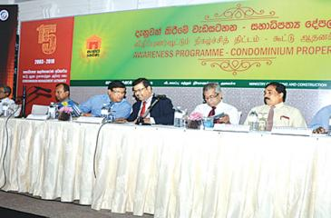 C.A. Wijeyeweere, Chairman CMA, R.M. Abeyratne, Secretary Ministry of Housing and Construction, L.S.Palansooriya, Chairman NHDA with guests at the head table.