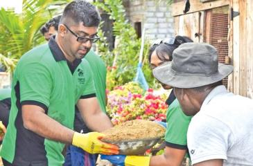 Board Chairman of Habitat for Humanity Sri Lanka - Mr.Lakshan Madurasinghe and members of the HFHSL National Board of Directors volunteering to construct homes for families in Muthurajawela