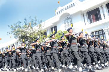 Pic: Wimal Karunatilake 70th Independence Day celebrations: Soldiers march in front of the Lake House building during the full dress rehearsal last Friday