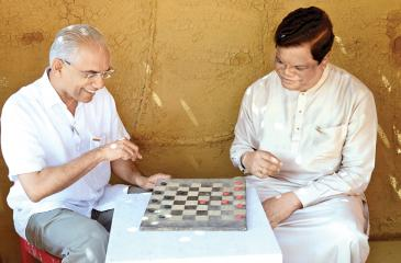 State Minister Finance Eran Wickramaratne and Joint Opposition MP Bandula Gunawardena were seen engaged in a friendly game of Checkers at the first 'Love Sri Lanka Festival' held at the Viharamahadevi Amphitheatre yesterday.  Pic: Shan Rupassara