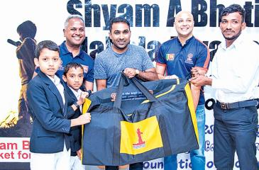 Former Sri Lanka captain Mahela Jayawardene, Ashan Malalasekera and Kushil  Gunasekera present cricket equipment bags to rural children.