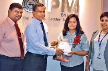 P.G. Tennakoon, Chief Operating Officer of IPM Sri Lanka presents the  scholarship to Sanjula Hettiarachchi. Gopinath Subramaniam, Director  Operations – Business School of IPM Sri Lanka (on left) and Chamika  Amarathunge, Assistant Center Manager – Kurunegala Branch, IPM Sri Lanka look on.