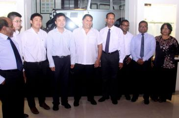 Galle Face Group Chairman Sanjeev Gardiner, Galle Face Hotel Management Senior Vice President Chandra Mohotti with senior officials from Zhen Hua Engineering Company Limited in Colombo. Pic: Chaminda Niroshana