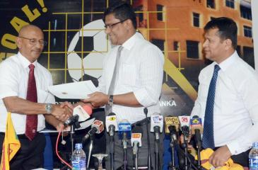 Newly appointed Sri Lanka National football coach Nizam Rumy Packeer Ali receiving the appointment letter from FFSL President Anura de Silva. Also in the picture is Usmar Umar, General Secretary