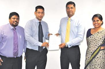 Manager, Membership Development, CIM Sri Lanka, Sanjay Hettiarachchi, Chairman, CIM Sri Lanka, Brian Selvanayagam, Chief Executive Officer, First Capital Holdings, Dilshan Wirasekara and Manager, Branding and Marketing Services, First Capital Holdings,  Ms. Nisansala Munasinghe at the signing of the MoU.