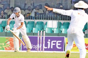 Nalanda batsman Dilhara Polgampola is bowled by Ananda's Shyamal Hirushan on the opening day of their Battle of the Maroons Big Match at  SSC ground yesterday (Picture by Saman Mendis)