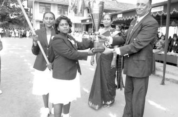 Picture shows the Captain of the Chitra House receiving the Lalith Fernando  Challenge Trophy from chief guest from Col. Manjula Kariyawasamm, Director  Ministry of Education (Sports)
