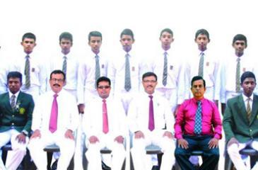 Boys Model School cricket squad seated from left Subhaga Weeratunga  (Captain) W.A. D.S. Ramyajith (Coach), Chandana Ratnayake (Asst. Coach), Sisira Guneratne (Principal), Upul Jayatissa (MIC - Cricket), A. Ashok (Asst. Coach), Yamesh Rashmika (Vice Captain) Back row from left Pansidu Hirusha, Chamitha Nimsara, Dulain Nimdiya, Kushan Mihiranga, Sameera Udayanga, Kavindu Sulochana, Tharindu Ahangama, Gamith Sandeepana, Thanuja Ahangama, Malin Anjana Bandara, Dulshan Ravishka, Duleep Dulaksha, Lahiru Prmudith