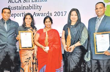 From left: Shanel Perera, Officer in Charge – Sustainable Business, Priyanka Wijayaratne, Senior Manager – Strategic Planning, Anusha Gallage, Chief Financial Officer, Chiranthi Cooray, Chief Human Resource Officer/Deputy General Manager – Human Resources and Hemantha Senanayake, Assistant Manager – Sustainable Business of HNB with the awards.