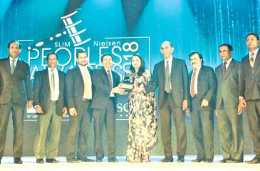 The People's Bank team receiving one of the two it won at the  SLIM-Nielson People's Awards 2018