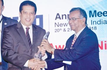 """Lakshman Silva,  CEO, DFCC Bank receiving the award for the """"Best Annual Report"""" from Dr. Sailendra Narain, Honorary Member, ADFIAP at the 41st Annual Meeting of ADFIAP."""