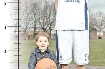 Brandon - believed to be the tallest teen in the world - with his four-year-old niece Isobelle Griffin