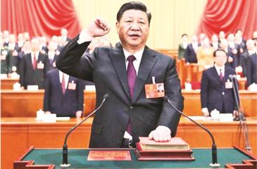 Xi Jinping takes a public oath of allegiance to the Constitution in the Great Hall of the People in Beijing, capital of China, March 17, 2018. Xi was elected Chinese president and chairman of the Central Military Commission of the People's Republic of China earlier Saturday at the ongoing first session of the 13th National People's Congress, the national legislature.  Xinhua/Ju Peng