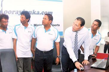 Sports Minister Dayasiri Jayasekera commissions the new sports website hooraylanka.com at a ceremony watched by its promoters Sanjaya Dissanayake (right) and Seevali Ediriweera (second from left). Others in the picture are Pulasthi Ediriweera and Kosala Perera