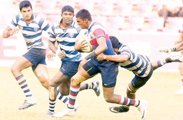 An Antonian player is tackled by a Joes opponent in their match last week. The Antonians have been the most disappointing team in the 2018 inter-school rugby season  Pic: Samantha Weerasiri