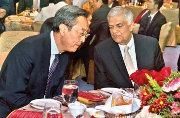 Pic: Vipula Amerasinghe Chairman of the Board of Supervisors of the Bank of China, Wang Xiquan in conversation with Prime Minister Ranil Wickremesinghe at the Bank of China launch event.