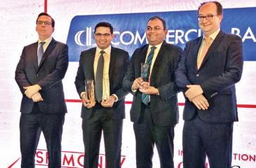 Commercial Bank's Deputy General Manager – Corporate Banking, Sanath Manatunge and Deputy General Manager, Marketing,  Hasrath Munasinghe (second and third from left) with the Asiamoney awards won by the Bank.
