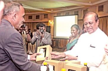 Pic: Chaminda Niroshana   Minister Susil Premajayantha receives the product.