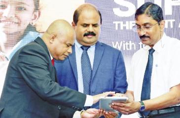 (From Left) Sunil Hettiarachchchi, Secretary – Ministry of Education, P. G. Kumarasinghe Sirisena, Chairman – Sri Lanka Telecom & Mobitel and Dr. Sarath Amunugama, Deputy Director General, Public Health Services officially launching the 'DengueFreeChild' app.