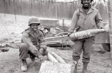 US soldiers of 969th Field Artillery Battalion decorate shells they're delivering to front line in Germany, 1944