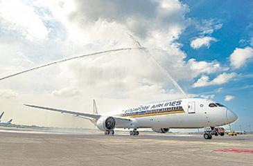 Singapore Airlines' 787-10 receives the water cannon salute to mark its  arrival in Singapore.