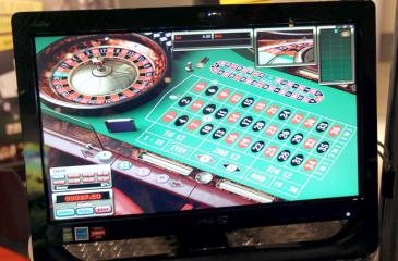 A screen broadcasts a virtual roulette table during Monaco's first professional online gaming and betting convention on October 11, 2010 at the Grimaldi forum in Monaco. This convention features a professional trading market, bringing together executives from the online gambling community, a series of conferences, and an awards ceremony. AFP PHOTO VALERY HACHE / AFP PHOTO / VALERY HACHE