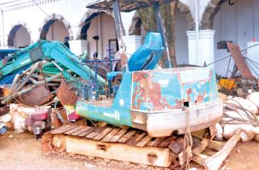 Backhoes and other confiscated equipment at the NGJA regional office, Ratnapura