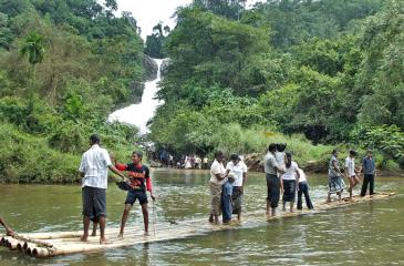NATURE'S WONDER: A magnificent Bopath Ella waterfall with bamboo boat