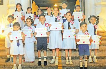 Winners in the 1st Category: Red Batch (Grade 1 to 5) of the All Island Art Competition conducted under the auspices of the YMBA, Colombo at the Lake House Amadahara Vesak Zone last week. Winners who received their prizes:    Front row from left - Senuri Dinethma Jayaratne (Musaeus Colleg e- Colombo) S.A.M. Hiruna Sadilka - Mayurapada K.V.    Second row from left - M.P. Rasanjana Vibhuthi Rajapaksha NK/Wa/Sanghabodhi M.M.V. Avulegama, W.V.D. Dulani Onadi Vithanage - Sri Devananda Dhamma School, H.M. Kalindu