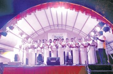 The Hayleys Bakthi Gee Singers performing on stage